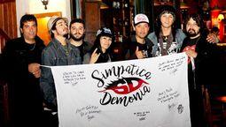 altText(Arena, sol y mucho rock: La banda hurlinghense Simpática Demonia lanzó el documental de su gira de verano)}